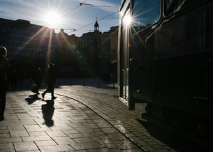 People walking and a tram on the streets of Helsinki, Finlandの写真素材 [FYI02211755]