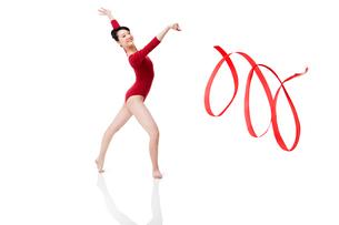 Female gymnast performing rhythmic gymnastics with ribbonの写真素材 [FYI02211960]