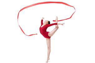 Female gymnast performing rhythmic gymnastics with ribbonの写真素材 [FYI02212069]