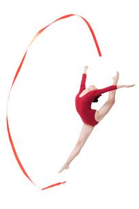 Female gymnast performing rhythmic gymnastics with ribbonの写真素材 [FYI02212154]