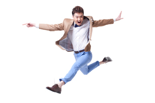 Trendy businessman jumping in mid-airの写真素材 [FYI02212177]