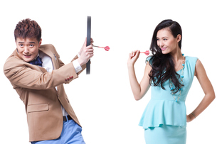 Stylish young people with darts and dartboardの写真素材 [FYI02212188]