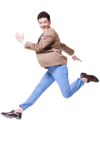 Stylish businessman jumping with excitementの写真素材 [FYI02212225]