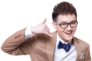 Trendy businessman doing call me gestureの写真素材 [FYI02212271]