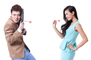 Stylish young people with darts and dartboardの写真素材 [FYI02212391]