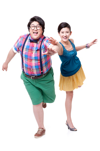 Funny fat man and girlfriend running forwardの写真素材 [FYI02212739]