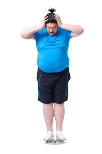 Overweight man on scale, shockedの写真素材 [FYI02212771]