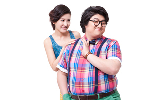 Funny overweight young man with girlfriendの写真素材 [FYI02213207]