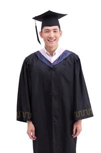 Happy college graduate in graduation gownの写真素材 [FYI02213261]