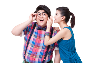 Young woman whispering in fat man's earの写真素材 [FYI02213335]