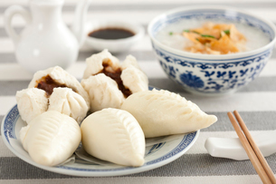 Chinese food rice porridge and cantonese barbecued pork bunsの写真素材 [FYI02213373]