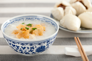 Chinese food rice porridge and cantonese barbecued pork bunsの写真素材 [FYI02213566]