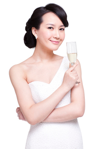 Graceful young woman with champagne fluteの写真素材 [FYI02213910]