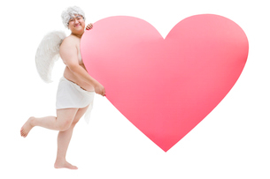 Chubby angel with a big heart shapeの写真素材 [FYI02213994]