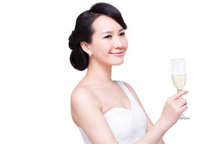 Graceful young woman with champagne fluteの写真素材 [FYI02214208]