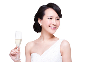 Graceful young woman with champagne fluteの写真素材 [FYI02214254]