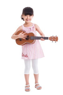 Cute little girl with guitarの写真素材 [FYI02214255]