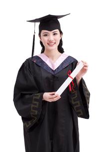 Happy college graduate in graduation gownの写真素材 [FYI02214287]