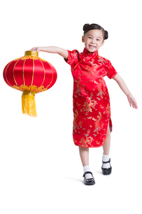 Cute girl with red lantern celebrating Chinese New Yearの写真素材 [FYI02214659]