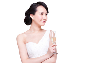 Graceful young woman with champagne fluteの写真素材 [FYI02214882]