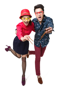 Happy young couple using chopsticksの写真素材 [FYI02214996]