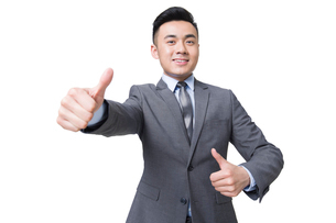 Young businessman giving thumbs upの写真素材 [FYI02215300]