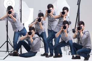 Multiple images of photographer taking picture in studioの写真素材 [FYI02215939]