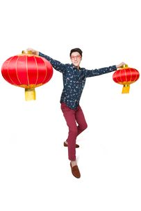 Young man celebrating Chinese new year with Chinese lanternsの写真素材 [FYI02217344]