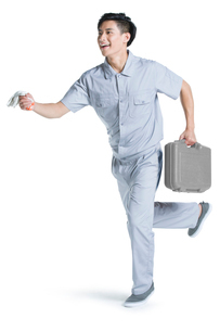 Repairman running with toolboxの写真素材 [FYI02220884]