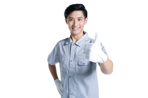 Technician giving thumbs upの写真素材 [FYI02223009]