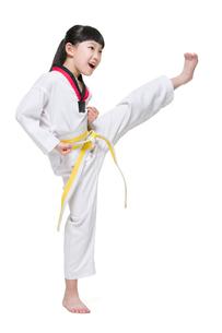 Cute girl practicing Tae Kwon Doの写真素材 [FYI02223760]