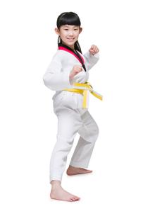 Cute girl practicing Tae Kwon Doの写真素材 [FYI02225013]