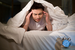 Young man suffering from insomniaの写真素材 [FYI02225379]