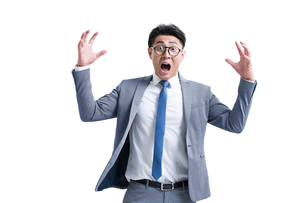 Shocked young businessmanの写真素材 [FYI02225421]