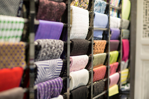 Different fabric swatches hanging on a designer's material rackの写真素材 [FYI02226452]