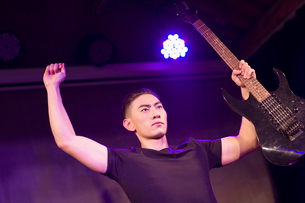 Young man with guitar on stageの写真素材 [FYI02227131]