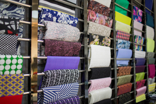 Different fabric swatches hanging on a designer's material rackの写真素材 [FYI02227416]