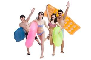 Happy young friends in swimsuit having funの写真素材 [FYI02227444]