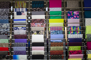 Different fabric swatches hanging on a designer's material rackの写真素材 [FYI02227771]