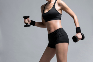 Young Chinese female athlete exercisingの写真素材 [FYI02228729]