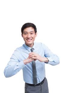 Cheerful young Chinese businessmanの写真素材 [FYI02229949]