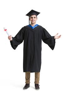 Happy college graduate in graduation gownの写真素材 [FYI02230232]