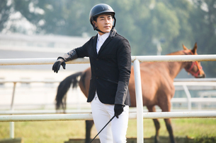 Chinese male rider looking at viewの写真素材 [FYI02230478]