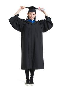 Happy college graduate in graduation gownの写真素材 [FYI02230847]