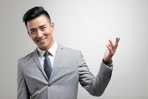 Portrait of cheerful young Chinese businessmanの写真素材 [FYI02231588]