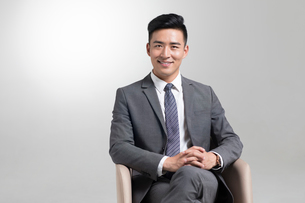 Portrait of cheerful young Chinese businessmanの写真素材 [FYI02232224]
