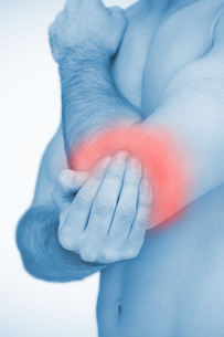 Man touching highlighted red elbow painの写真素材 [FYI02232829]