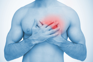 Man touching highlighted chest painの写真素材 [FYI02233134]
