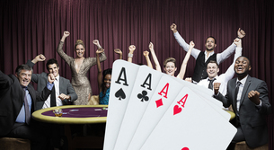 Attractive group cheering at the casino with digital hand of cardsの写真素材 [FYI02233327]