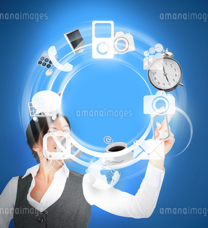 Wheel of various computer applications interface used by businesswomanの写真素材 [FYI02233427]